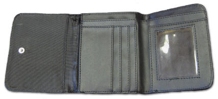 Inside small wallet showing pockets.