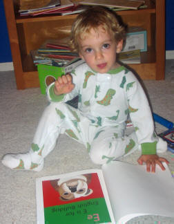 Isaac loves his new ABC Book.